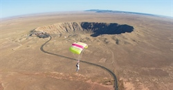 Skydivers Jump Over Meteor Crater